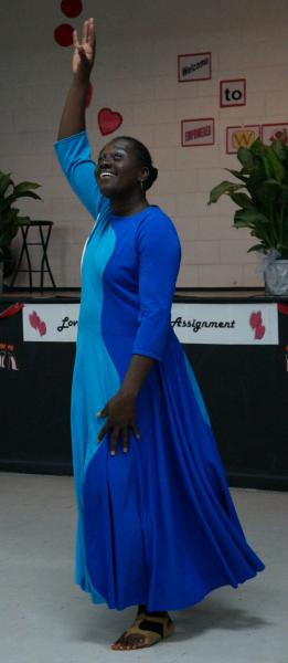 PICTURE OF LAVERNE D JOSEPH CAPTURED  AS SHE MINISTERS IN A PRAISE DANCE AT AN EMPOWERED WOMEN CONFERENCE